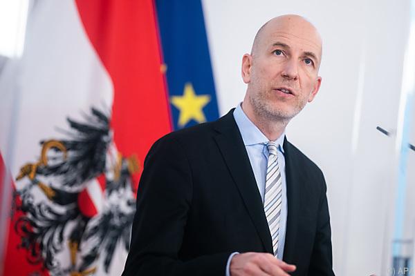 Auf dem Foto sieht man Arbeitsminister Martin Kocher